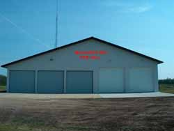 A fire department building with 5 garage doors