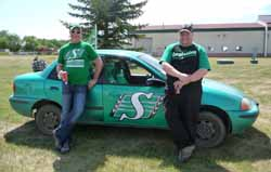 2 men with with a green car at Saskatchewan Day